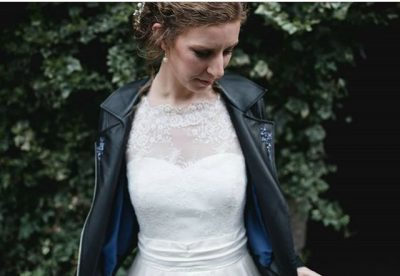 Bridie wears a born to thread black leather jacket on her wedding day