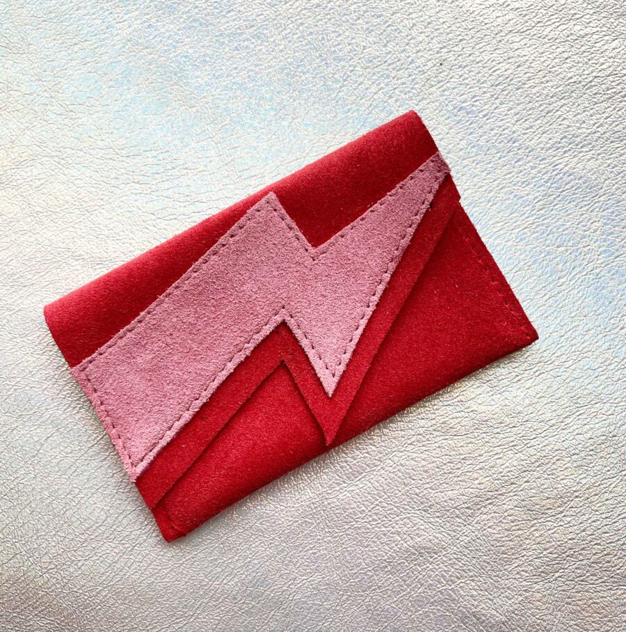 read and pink suede purse